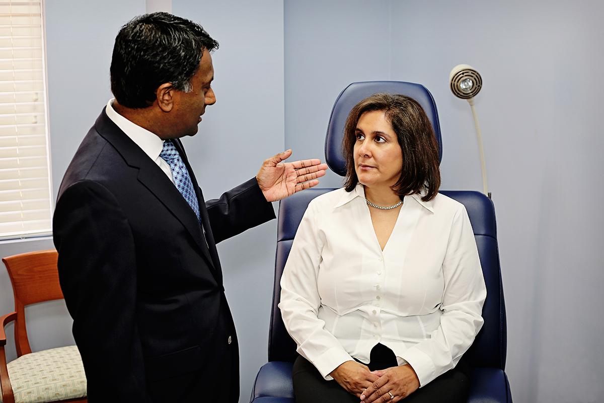 A patient meets with Board Certified Plastic Surgeon Dr Malik Kutty